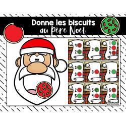 Donne les biscuits au Père Noël